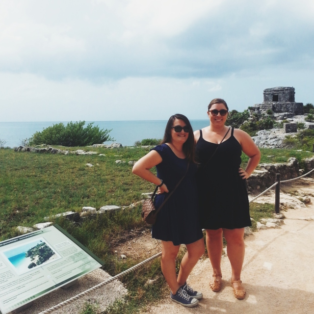 Two girls in front of Mayan ruins